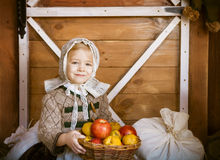 Vintage styled photo of little smiling girl in farm Stock Photos