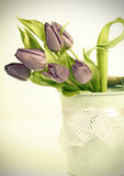 Vintage styled photo of purple tulips bouquet Stock Photography