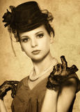Vintage styled portrait of a beautiful woman Stock Image