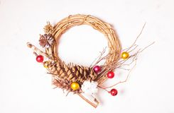 Vintage stylish Christmas wreath. With minimal details, golden and red baubles stock photography