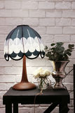 Vintage stylish lamp. And white rose decoration with white brick wall Royalty Free Stock Photo
