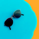 Vintage stylish sunglasses on bright background Royalty Free Stock Images