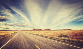 Vintage stylized country road, travel concept Royalty Free Stock Images