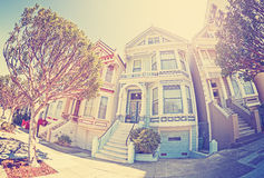 Vintage stylized fisheye lens street photo of Painted Ladies. Stock Photos