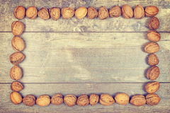 Vintage stylized framed background made of walnuts Royalty Free Stock Images