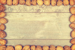 Vintage stylized framed background made of walnuts Royalty Free Stock Image