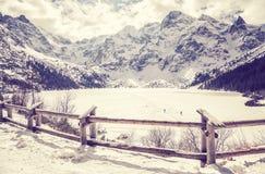Vintage stylized frozen lake Morskie Oko in Polish Tatra Mountai Stock Images