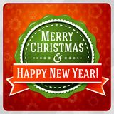 Vintage stylized green Merry Christmas and Happy. New Year label, with red ribbon Stock Photo