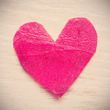 Vintage stylized heart made of beet on grunge background. Stock Images