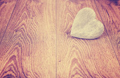 Vintage stylized heart on wooden boards. Royalty Free Stock Image