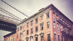 Vintage stylized old building in Dumbo neighborhood, New York. Vintage stylized old building in Dumbo neighborhood, New York City, USA royalty free stock photography