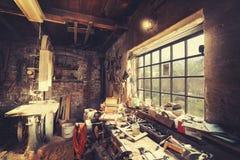 Vintage stylized old carpenter workshop interior.  Stock Image