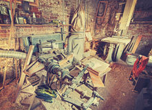 Vintage stylized old carpenter workshop interior Stock Image