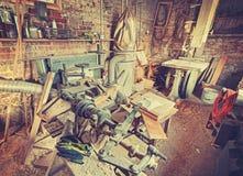 Vintage stylized old carpenter workshop interior Stock Image