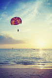 Vintage stylized paragliders at sunset, summer adventure concept Stock Images