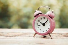 Vintage stylized photo of alarm clock Stock Photos