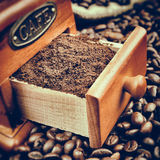 Vintage stylized photo of coffee grinder and coffee beans Stock Image