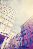 Vintage stylized photo of old and new architecture in Dumbo, NY. Royalty Free Stock Photos