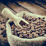 Vintage stylized photo of sack with coffee beans Stock Photos