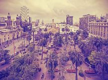 Vintage stylized photo of Santiago de Chile. Vintage stylized photo of Santiago de Chile downtown, Plaza de Armas where modern skyscrapers mix with historic Stock Photography