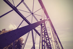 Vintage stylized photo of a steel bridge. Royalty Free Stock Photo