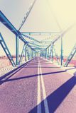 Vintage stylized photo of a steel bridge with sun light Stock Photos