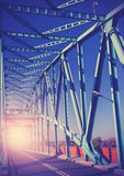 Vintage stylized photo of a steel bridge with sun light Royalty Free Stock Photos