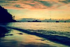 Vintage stylized photo of sunrise on the beach Stock Image