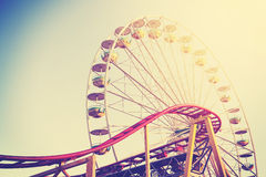 Vintage stylized picture of an amusement park. Royalty Free Stock Photo