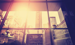 Vintage stylized picture of Manhattan with sun flare effect. Royalty Free Stock Image