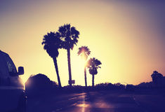 Vintage stylized picture of road against sunset, USA. Stock Photos