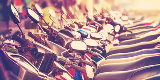 Vintage stylized picture of scooters in a row Royalty Free Stock Image