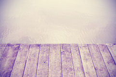 Vintage stylized picture of wooden boards and lake. Stock Images