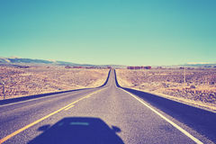 Vintage stylized shadow of a car on an empty road. Stock Photography