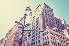 Vintage stylized street corner in Manhattan, New York. Stock Images