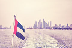 Vintage stylized  United Arab Emirates flag with Dubai skyline i Royalty Free Stock Photos