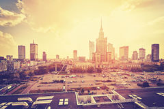 Vintage stylized Warsaw downtown at sunset. Vintage stylized Warsaw downtown with Palace of Culture and Science and skyscrapers at sunset, Poland royalty free stock image