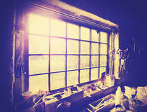Vintage stylized window in carpenters workshop Stock Images