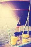 Vintage stylized yellow bollard holding ship moored. Stock Photo