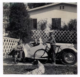 Vintage Success. Vintage photo of successful father in convertible with two children on bikes. Circa 1953 Stock Photos