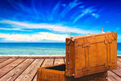 Vintage Suitcase at Boardwalk and Open Sea Royalty Free Stock Image