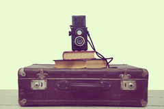 Vintage suitcase with books and camera Stock Images