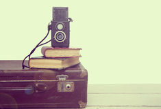 Vintage suitcase with books and camera Royalty Free Stock Image