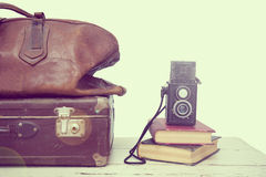 Vintage suitcase with books and camera Royalty Free Stock Photo