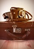 Vintage suitcase and camera Stock Images