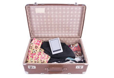 Vintage Suitcase with clothing and modern ebook Stock Photography