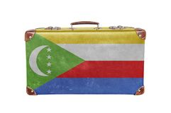 Vintage suitcase with Comoros flag. Close Royalty Free Stock Images