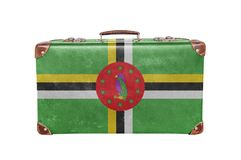 Vintage suitcase with Dominica flag. Close royalty free stock image