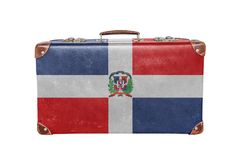 Vintage suitcase with Dominican Republic flag. Close stock photography