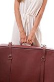 Vintage suitcase in female hands Stock Photo